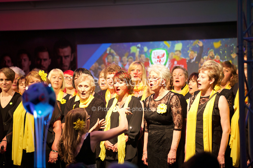CARDIFF, WALES - Wednesday, June 1, 2016: Tenovus choir perform during a charity send-off gala dinner at the Vale Resort Hotel ahead of the UEFA Euro 2016. (Pic by David Rawcliffe/Propaganda)