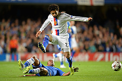 LONDON, ENGLAND - September 18:  Chelsea's Ashley Cole tackles Basel's Mohamed Salah during the UEFA Champions League Group E match between Chelsea from England and Basel from Switzerland played at Stamford Bridge, on September 18, 2013 in London, England. (Photo by Mitchell Gunn/ESPA)