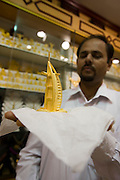 Deira. Gold Souq. Small Burj Al Arab in gold.