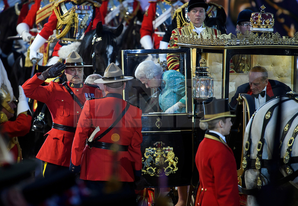 © Licensed to London News Pictures. 15/05/2016. Windsor, UK.  HRH QUEEN ELIZABETH II and PRINCE PHILIP, THE DUKE OF EDINBURGH, arrive at the arena . An evening event held at the Royal Windsor Horse show to celebrate the 90th birthday of HRH Queen Elizabeth II. Acts from arounds the world have been invited to perform at the evening event, set in the grounds of Windsor Castle. Photo credit: Ben Cawthra/LNP