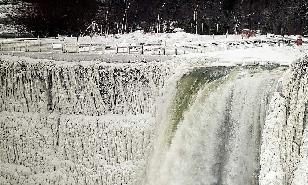 Niagara Falls, Ontario ---1/10/2014--- Water still cascades over Niagara Falls January 10, 2014 which nearly froze over on the American side during the recent cold snap caused by the shift in the Arctic Vortex. GEOFF ROBINS AFP