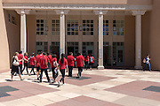 Prospective students on a campus tour walk in to Zimmerman Library on the central campus of the University of New Mexico on Thursday June 2, 2016.