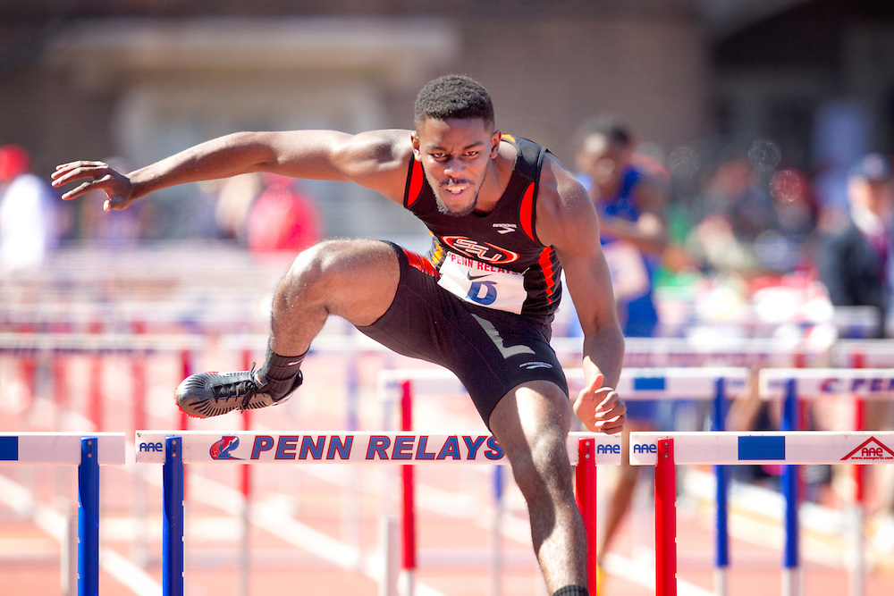 2013 Penn Relays Friday April 26th,  Here, Randy Thomas clears the final hurdle as Savannah State wins the CM Shuttle Hurdles Championship ( ED HILLE / Staff Photographer )