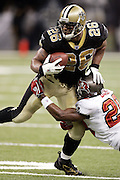 NEW ORLEANS - OCTOBER 10:  Running back Deuce McAllister #26 of the New Orleans Saints shakes off a tackle by cornerback Ronde Barber #20 of the Tampa Bay Buccaneers at the Louisiana Superdome on October 10, 2004 in New Orleans, Louisiana. McAllister rushed for 102 yards on 21 carries but fumbled twice, losing one of them to the Bucs. The Bucs defeated the Saints 20-17. ©Paul Anthony Spinelli *** Local Caption *** Deuce McAllister, Ronde Barber