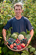 Rich  Hildner, owner Smith Berry Barn, with basket of Oregon Fruit sold at his farm:  raspberries, blueberries, blackberries, peaches, apples, cherries, watermelon, and cantelope