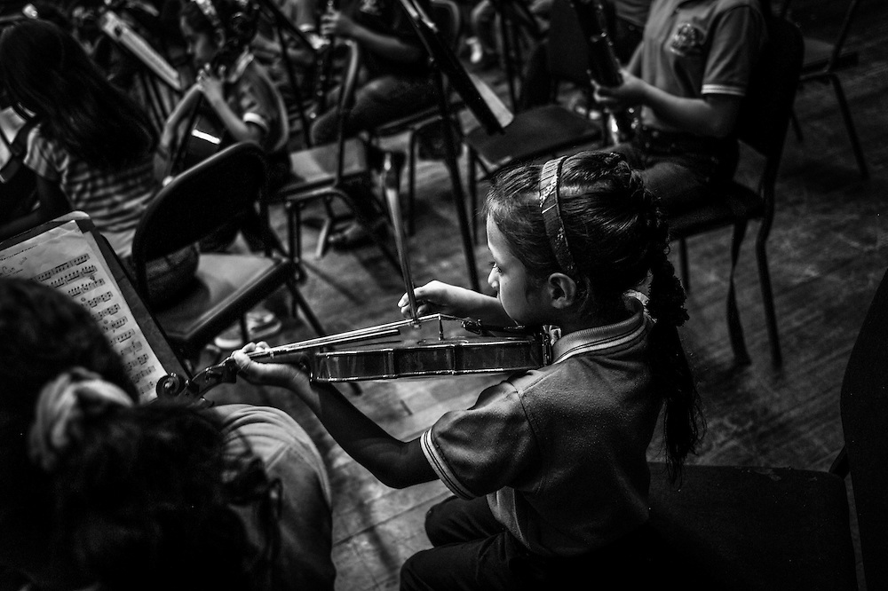 Children learn to play classical music at the Sarria nucleo, of the El Sistema music program in a dangerous slum in Caracas, Venezuela.