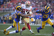 Dec 30, 2018; Los Angeles, CA, USA; San Francisco 49ers tight end George Kittle (85) battles with Los Angeles Rams strong safety John Johnson (43) and Los Angeles Rams inside linebacker Mark Barron (26) at Los Angeles Memorial Coliseum. The Rams defeated the 49ers 48-31.  (Robin Alam/Image of Sport)