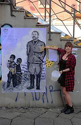Italy, Milan -  October 8, 2018.Protest Graffiti against Matteo Salvini by the Italian artist Cristina Donati Meyer - here pictured (Credit Image: © Maule/Fotogramma/Ropi via ZUMA Press)