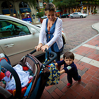 WINTER PARK, FL -- Ryder McGlamery helps his mother push a stroller down Park Ave. in Winter Park, Fla., on Friday, January 27, 2012. As the Florida Primary approaches, the voters along the I-4 corridor are becoming an increasingly more important path to securing a win.  (Chip Litherland for The New York Times)