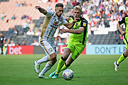 MKDons midfielder Lawson D'Ath (20) and Exeter City forward Jayden Stockley (11) during the EFL Sky Bet League 2 match between Milton Keynes Dons and Exeter City at stadium:mk, Milton Keynes, England on 25 August 2018.