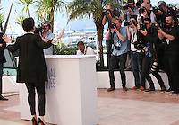 Actress Juliette Binoche with photographers at the photo call for the film Sils Maria at the 67th Cannes Film Festival, Friday 23rd May 2014, Cannes, France.