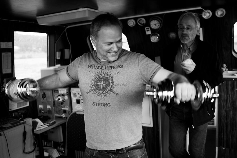 Captain Svein Ivar Vinnes exercising on the bridge. Vidar Kursetgjerde coming up from behind..Photo by Knut Egil Wang /MOMENT