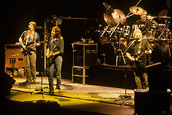 Phil Lesh, Bob Weir and Jerry Garcia signing with drummer Bill Kreutzmann. The Grateful Dead in Concert at the Brendan Bryne Arena, East Rutherford NJ, on March 30th 1988. View front of stage at level from stage left arena.