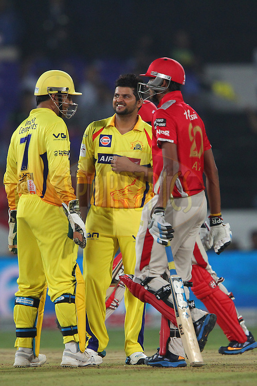 Suresh RAINA of the Chennai Superkings celebrates the wicket of Akshar PATEL of the Kings XI Punjab  during the second semi final match of the Oppo Champions League Twenty20 between the Kings XI Punjab and the Chennai Superkings held at the Rajiv Gandhi Cricket Stadium, Hyderabad, India on the 2nd October 2014<br /> <br /> Photo by:  Ron Gaunt / Sportzpics/ CLT20<br /> <br /> <br /> Image use is subject to the terms and conditions as laid out by the BCCI/ CLT20.  The terms and conditions can be downloaded here:<br /> <br /> http://sportzpics.photoshelter.com/gallery/CLT20-Image-Terms-and-Conditions-2014/G0000IfNJn535VPU/C0000QhhKadWcjYs