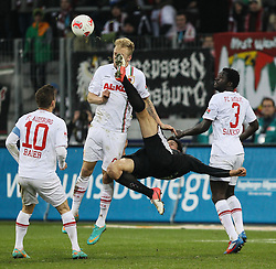 01.12.2012, SGL Arena, Augsburg, GER, 1. FBL, FC Augsburg vs SC Freiburg, 15. Runde, im Bild Fallrueckzieher am Mann durch Ivan SANTINI(SC Freiburg) gegen Kevin VOGT (FC Augsburg), Daniel BAIER (FC Augsburg, 10), Gibril SANKOH (FC Augsburg, re. 3), Gelbe Karte gegen Ivan SANTINI(SC Freiburg) // during the German Bundesliga 15th round match between FC Augsburg and SC Freiburg at the SGL Arena, Augsburg, Germany on 2012/12/01. EXPA Pictures © 2012, PhotoCredit: EXPA/ Eibner/ Klaus Rainer Krieger..***** ATTENTION - OUT OF GER *****