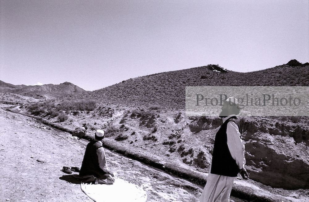 On the roads of Khost's region, travelers stop their journey to pray.