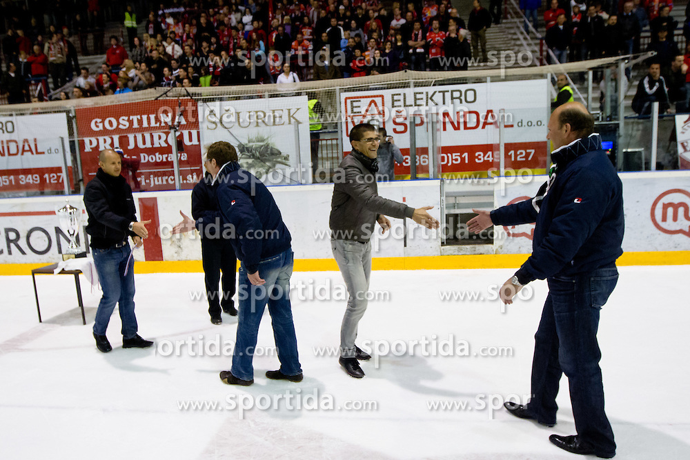 Hannu Jarvenpaa, head coach of HDD Tilia Olimpija, and Andrej Hebar  receiving medal after ice-hockey match between HK Acroni Jesenice and HDD Tilia Olimpija in fourth game of Final at Slovenian National League, on April 2, 2012 at Dvorana Podmezaklja, Jesenice, Slovenia. HDD Tilia Olimpija won 5:2 and become national champions in season 2011/12. (Photo By Matic Klansek Velej / Sportida.com)