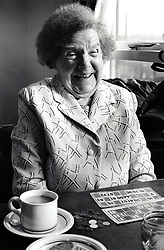 Portrait of an elderly woman playing bingo at Edwards Lane Community Centre, Nottingham, UK, 1989