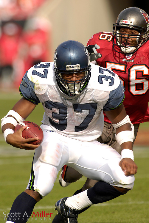 Dec. 31, 2006; Tampa, FL, USA; Seattle Seahawks running back (37) avoids Tampa Bay Buccaneers defender (56) Ryan Neece during the first half of the Seahawks game against the at Raymond James Stadium. ...©2006 Scott A. Miller