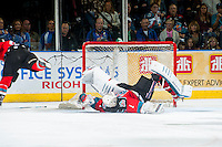 KELOWNA, CANADA - OCTOBER 11: Jackson Whistle #1 of Kelowna Rockets does a roll over save after a shot on net by the Lethbridge Hurricanes in the second period on October 11, 2014 at Prospera Place in Kelowna, British Columbia, Canada.   (Photo by Marissa Baecker/Shoot the Breeze)  *** Local Caption *** Jackson Whistle;