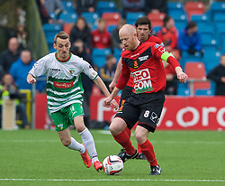 NEWTOWN, WALES - Saturday, May 2, 2015: Newtown's captain Matthew Cook in action against The New Saints' Jamie Mullan during the FAW Welsh Cup final match at Latham Park. (Pic by Ian Cook/Propaganda)