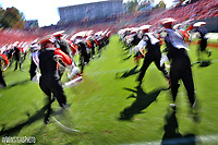 """The marching band """"run dances"""" out onto the field before the UNC football game."""