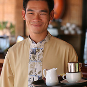 A waiter carries a tray of Vietnamese drip coffee at the Victoria resort, Mui Ne.