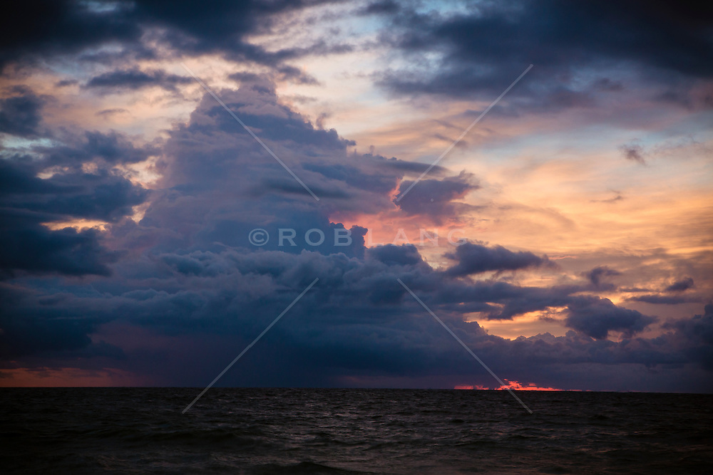 storm clouds at sunrise over the ocean in Florida