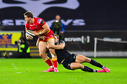 Dragons' Hallam Amos is tackled by Ospreys' Cory Allen - Mandatory by-line: Craig Thomas/JMP - 27/10/2017 - RUGBY - Liberty Stadium - Swansea, Wales - Ospreys v Dragons - Guinness Pro 14