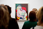 """UNITED KINGDOM, London: 06 March 2018 Visitors take a close look at Picasso's """"The Dream"""" (1932) at The Tate Modern's new exhibition 'Picasso 1932: Love, Fame, Tragedy'. The exhibition, which consists of a wide range of Picasso works, runs from 8th March - 9 September 2018.  Rick Findler / Story Picture Agency"""