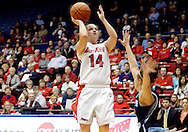 UD junior Samantha MacKay (14) as the Rhode Island Rams play the University of Dayton Flyers at UD Arena in Dayton, Saturday, January 7, 2012.