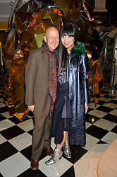 STEPHEN JONES and SUSIE LAU at a party to celebrate theunveiling of the Claridge's Christmas Tree designed by Christopher Bailey for Burberryheld at Claridge's, Brook Street, London on 18th November 2015.