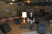 "Tyler Morrison poses in the upstairs rehearsal area as Wise ""Doc"" Smith entertains guests in the 13,000-sq.-ft. building that is the future home of Liquid Sound Studios, Thursday, July 26, 2012, on Corydon Pike in New Albany, Ind. (Photo by Brian Bohannon)"