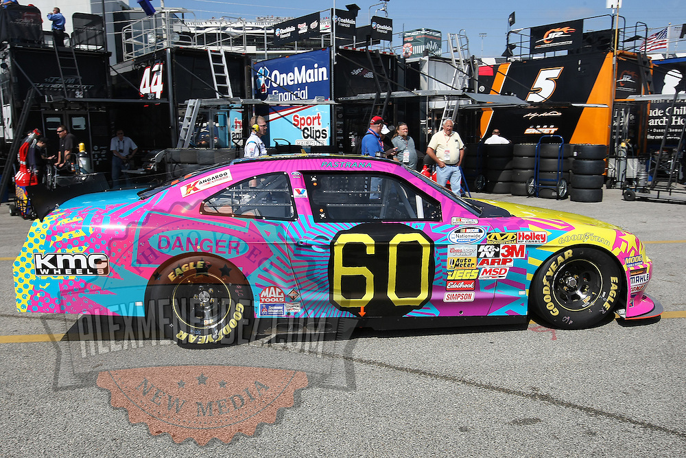 The car with the wild paint job is the Rousch-Fenway Racing Ford  of driver Travis Pastrana during a NASCAR Drive4COPD Nationwide Series practice session at Daytona International Speedway on Thursday, February 21, 2013 in Daytona Beach, Florida.  (AP Photo/Alex Menendez)
