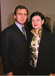 DR ERIC THEVENET and designer PALOMA PICASSO daughter of artist Pablo Picasso,  at an exhibition in London on 15th September 1998.MKB 8
