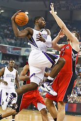 November 1, 2010; Sacramento, CA, USA;  Sacramento Kings point guard Tyreke Evans (13) shoots past Toronto Raptors center Andrea Bargnani (7) during the first quarter at the ARCO Arena.