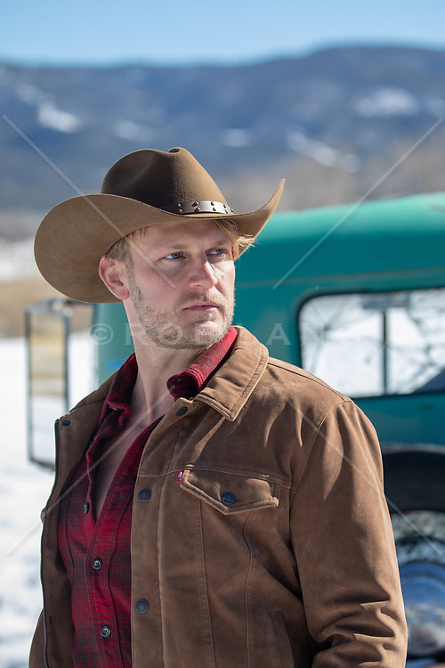 cowboy by a pick up truck