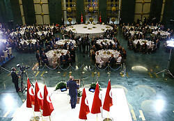 June 15, 2017 - Ankara, Turkey - Turkish President Recep Tayyip Erdogan delivers a speech at an iftar in the capital Ankara on 15 June, Turkey. Erdogan has criticized the U.S. move to issue arrest warrants for 12 of his bodyguards allegedly linked with a brawl outside the Turkish embassy in Washington. Erdogan said,''They have issued arrest warrants for 12 of my bodyguards. What kind of law is this? If my bodyguards cannot protect me then why am I bringing them to America with me?'' Several people were injured when a brawl broke outside Turkey's Washington embassy during Erdogan's visit to the U.S. in May. Washington D.C. police reportedly obtained the arrest warrants for the Turkish president's bodyguards on Thursday. The president explained that PKK terrorists and members of Fetullah Terrorist Organization (FETO) were united in protest against him at a short distance of 40-50 meters from where he was with his bodyguards.''The US police is doing nothing. Can you imagine what the response would have been if a similar incident had taken place in Turkey?'' Erdogan added. (Credit Image: © Turkish Presidency Press Service/Depo Photos via ZUMA Wire)