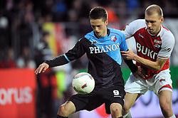 03-04-2010 VOETBAL: AZ - FC UTRECHT: ALKMAAR<br /> FC Utrecht verliest met 2-0 van AZ / Ricky van Wolfswinkel en Ragnar Klavan<br /> ©2010-WWW.FOTOHOOGENDOORN.NL