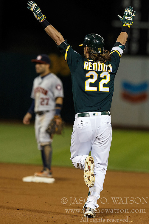 OAKLAND, CA - JULY 19:  Josh Reddick #22 of the Oakland Athletics celebrates after hitting a walk off single against the Houston Astros during the tenth inning at the Oakland Coliseum on July 19, 2016 in Oakland, California. The Oakland Athletics defeated the Houston Astros 4-3 in 10 innings.  (Photo by Jason O. Watson/Getty Images) *** Local Caption *** Josh Reddick