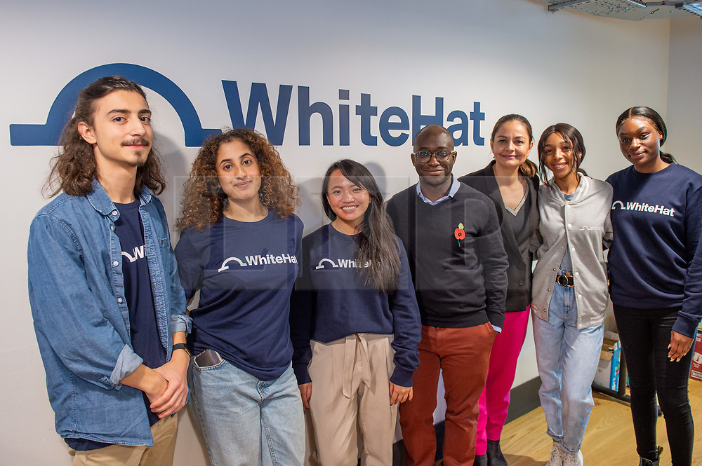 © Licensed to London News Pictures. 11/11/2019. London, UK. Liberal Democrat Shadow Business, Energy and Industrial Strategy Secretary Sam Gyimah and London Mayoral candidate Siobhan Benita stand with apprentices during a visit to 'WhiteHat', a tech start-up founded to help people access apprenticeships. , to discuss the party's plans for the creation of an ambitious Skills Wallet which gives every adult £10,000 to spend on education and training throughout their lives. Photo credit: Peter Manning/LNP