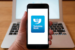 Using iPhone smartphone to display logo of Yorkshire Bank