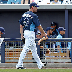 March 21, 2012; Port Charlotte, FL, USA; Tampa Bay Rays relief pitcher Kyle Farnsworth (43) exits the game during the top of the second inning of a spring training game against the New York Yankees at Charlotte Sports Park.  Mandatory Credit: Derick E. Hingle-US PRESSWIRE