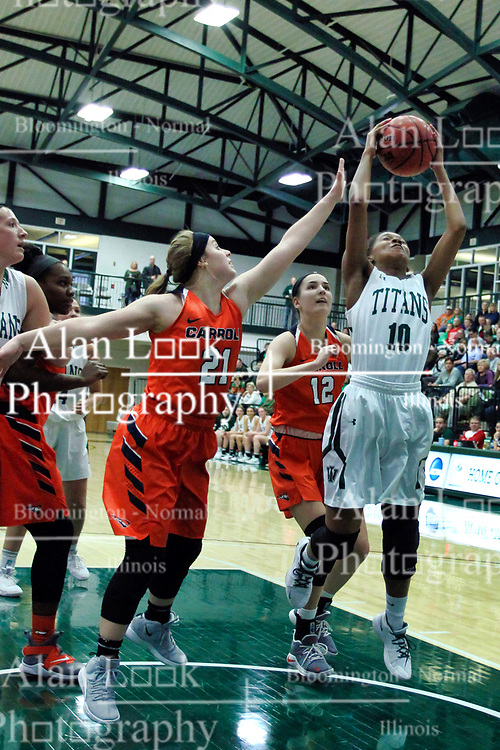 BLOOMINGTON, IL - December 15: Theresa Wichser, Celina Schwantes and Raven Hughes during a college women's basketball game between the IWU Titans  and the Carroll Pioneers on December 15 2018 at Shirk Center in Bloomington, IL. (Photo by Alan Look)