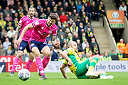 QPR Midfielder Paweł Wszołek (23) is caught by Norwich City midfielder Marco Stiepermann (18) during the EFL Sky Bet Championship match between Norwich City and Queens Park Rangers at Carrow Road, Norwich, England on 6 April 2019.