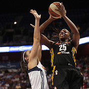 Glory Johnson, Tulsa Shock, shoots while challenged by Kelly Faris, Connecticut Sun, during the Connecticut Sun V Tulsa Shock WNBA regular game at Mohegan Sun Arena, Uncasville, Connecticut, USA. 2nd July 2013. Photo Tim Clayton