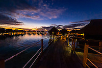 Overwater bungalows at twilight, Hilton Moorea Lagoon Resort, island of Moorea, French Polynesia.