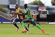 Tom Elliott of AFC Wimbledon battles Nicky Hunt during the Sky Bet League 2 match between Mansfield Town and AFC Wimbledon at the One Call Stadium, Mansfield, England on 5 September 2015. Photo by Stuart Butcher.
