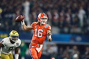 Clemson Tigers quarterback Trevor Lawrence (16) throws a pass under pressure from Notre Dames Daelin Hayes (9) during the game of the NCAA Cotton Bowl semi-final playoff football game, Saturday, Dec. 29, 2018, in Arlington, Texas. Clemson defeated Notre Dame 30-3 to advance to the College Football Playoff national Championship. (Mario Terana/Image of Sport)
