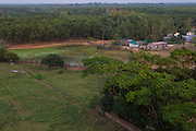 An aerial view of a few houses and trees in a rural setting in Bangladesh.